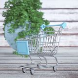Shopping Cart Trolley on a Wooden Plank Table. 3d Rendering royalty free stock images
