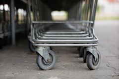 The shopping cart trolleys are placed under the market. Shopping stock photos