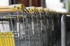 The shopping cart trolleys are placed under the market. Shopping stock images