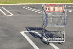 SHOPPING CART TROLLY IN A PARKING LOT Stock Photo