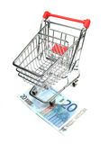 Shopping cart and twenty euro banknote Stock Image