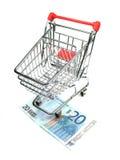 Shopping cart and twenty euro banknote Stock Image