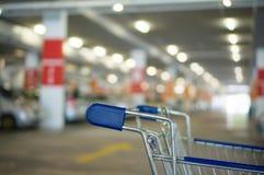 Shopping cart on underground parking in supermarket. Shopping cart on underground parking Stock Images