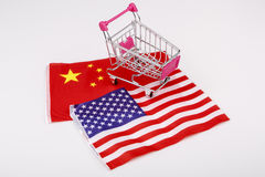 Shopping cart with USA and China flag. Ping shopping cart with USA and China flag - China and United states royalty free stock photo