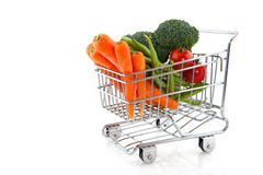 Shopping cart with vegetables Stock Image