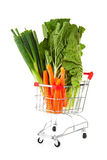Shopping cart with vegetables. Over white background Stock Image