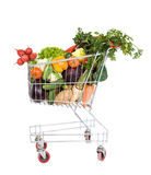 Shopping cart with vegetables. Shopping cart filled with fresh vegetables - isolated Royalty Free Stock Photo