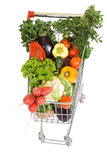 Shopping cart with vegetables. Shopping cart full with vegetables, top view, isolated on white Stock Image
