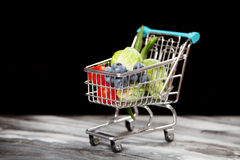 Shopping cart with vegetables on black background.  Stock Photos