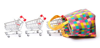Shopping Cart with Vibrant Bag Royalty Free Stock Photos