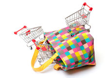 Shopping Cart with Vibrant Bag Stock Image