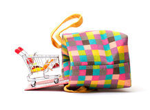 Shopping Cart with Vibrant Bag Stock Images