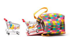 Shopping Cart with Vibrant Bag Royalty Free Stock Images