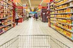 Shopping Cart View On Supermarket Aisle Stock Image
