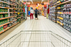 Shopping Cart View On Supermarket Aisle Royalty Free Stock Images