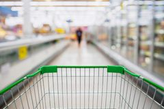 Shopping Cart View in Supermarket Aisle Milk Yogurt Frozen Food Royalty Free Stock Photo
