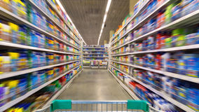 Shopping Cart View on a Supermarket. Aisle and Shelves - Image Has a Shallow Depth of Field Stock Photography