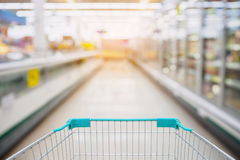 Shopping Cart View in Supermarket Aisle Royalty Free Stock Photography