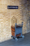 Shopping cart in the wall at platform 9 three-quarter Royalty Free Stock Photo