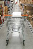 Shopping cart warehouse Royalty Free Stock Photography