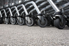 Shopping cart wheels. Low angle of shopping cart wheels Royalty Free Stock Images