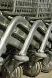 Shopping Cart Wheels. Close-up of steel shopping carts Stock Photography