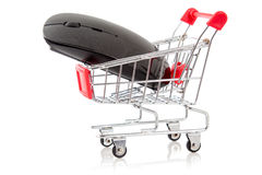 Shopping cart with wireless computer mouse Royalty Free Stock Photography