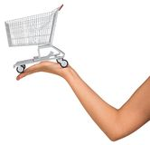 Shopping cart in womans hand Stock Photo