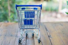 Shopping cart on wood table. For shopping online concept Stock Images