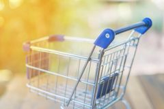 Shopping cart on wood table. For shopping online concept Royalty Free Stock Image