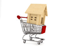 Shopping Cart with Wooden House Royalty Free Stock Photos