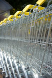 Shopping carts. Many metal shopping carts with yellow handles outdoor Royalty Free Stock Photo