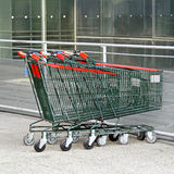 Shopping carts. Several empty shopping carts at supermarket parking Royalty Free Stock Images