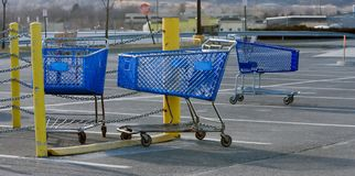 Shopping Carts. Three shopping carts in an empty parking lot Stock Images