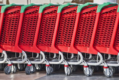 Shopping carts. In a row Royalty Free Stock Photos