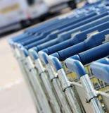 Shopping carts. Many shopping carts in a row are waiting for using Stock Photos