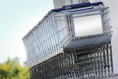 Shopping carts. Many shopping carts in a row are waiting for using Stock Images