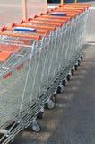 Shopping carts. Row of metal shopping carts at supermarket parking Royalty Free Stock Photos