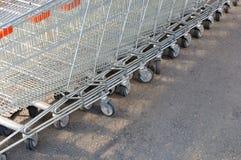 Shopping carts. Row of metal shopping carts at supermarket parking Stock Images
