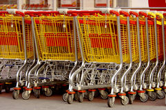 Shopping carts. Many shopping carts going to the side out of focus Stock Photos