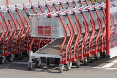 Shopping carts. Many shopping carts going to the side out of focus Stock Image