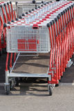 Shopping carts. Many shopping carts going to the side out of focus Stock Photography