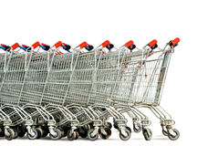 Shopping carts. Row of shopping trolley isolated over white background royalty free stock image