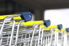 Shopping carts. In the row Royalty Free Stock Images
