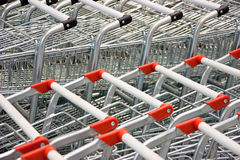 Shopping carts. Two rows of shopping carts with red and black handles Stock Images