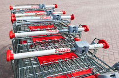 Shopping carts Auchan store. French distribution network Auchan Royalty Free Stock Photo