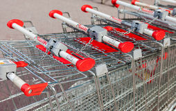 Shopping carts Auchan store. French distribution network Auchan Stock Photography