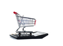 Shopping carts on calculator Royalty Free Stock Photography
