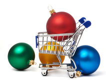 Shopping carts and Christmas colored balls Stock Photo