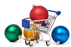 Shopping carts and Christmas colored balls Stock Photos